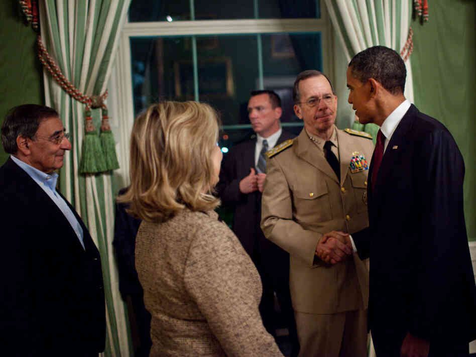 President Obama and Adm. Mike Mullen, Joint Chiefs chair, shake hands following the president's announcement that U.S. forces killed Osama bin Laden, May 1, 2011.