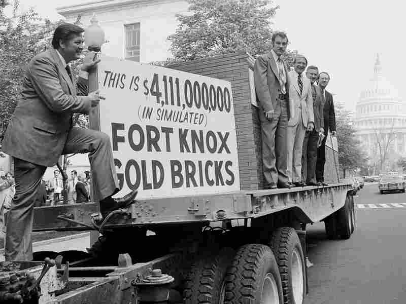 Texas Republican Rep. Ron Paul (fourth from right), Idaho Republican Rep. George Hansen (left) and other members of Congress gather around a truck loaded with 44,300 simulated gold bricks on April 25, 1979, in Washington to indicate their opposition to the estimated $4.1 billion it would cost U.S. taxpayers to give away the Panama Canal.