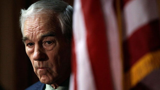 Rep. Ron Paul waits to speak at a news conference in April in Des Moines, Iowa.