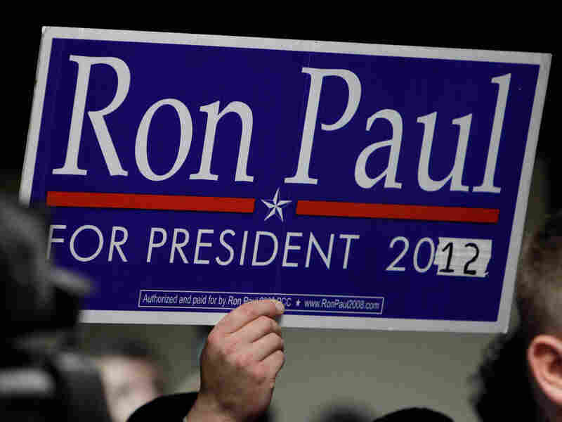 A supporter holds a sign as Paul speaks in Des Moines, Iowa, in April.