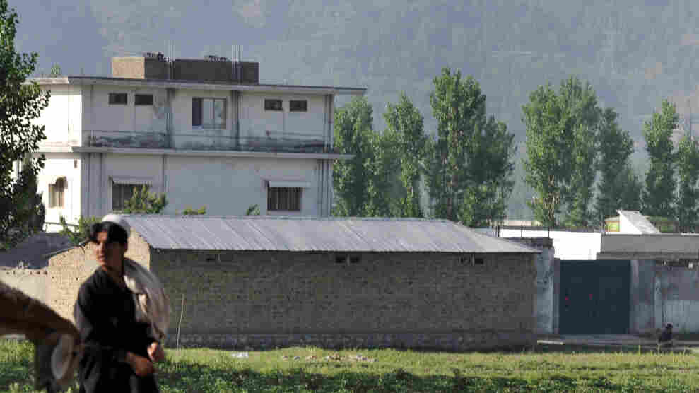 A Pakistani shepherd in Abbottabad walks past the hideout of al-Qaida leader Osama bin Laden, who was killed in a U.S.-led ground operation early Monday.