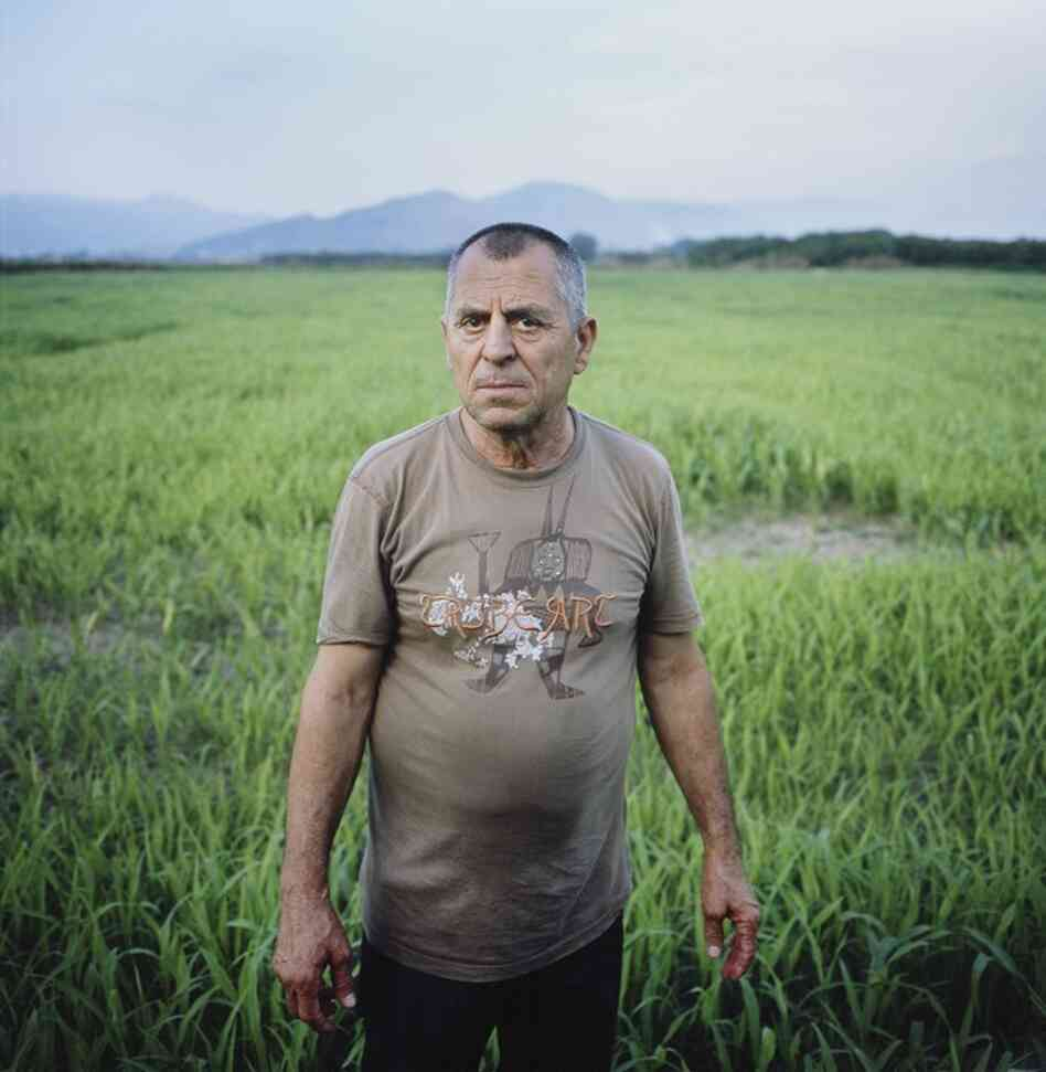Mario Cannavacciuolo, a sheepherder, stands on his abandoned land outside Acerra, Italy. His family land has been destroyed by illegal toxic waste disposal and a nearby government-sponsored garbage incinerator. Cannavacciuolo's 3,000 sheep died from dioxin contamination. His brother Enzo died shortly after, and tests showed his body contained levels of dioxin and PCBs 30 times the amount allowe...
