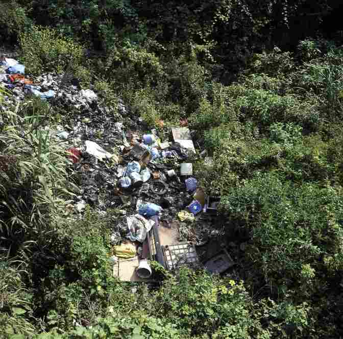 Piles of illegally disposed-of televisions, computers, trash and containers of toxic chemicals lie abandoned next to an irrigation canal for local farms near Marigliano. Piles of urban waste can be found throughout the provinces of Naples and Caserta.