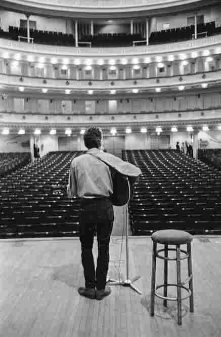 "1963: Bob Dylan faces an empty house before his first concert as a Carnegie Hall headliner in October of that year. His set list that night included ""The Times They Are A-Changin"" and ""A Hard Rain's A-Gonna Fall."""