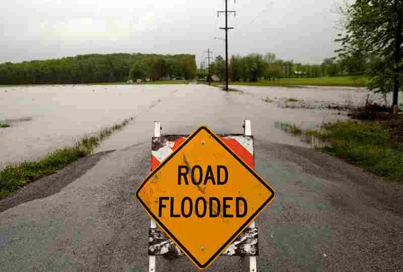 April 27: A sign blocks a flooded road in Vienna, Ill. Severe storms caused rivers and streams to rise in parts of southeastern Missouri and southern Illinois.