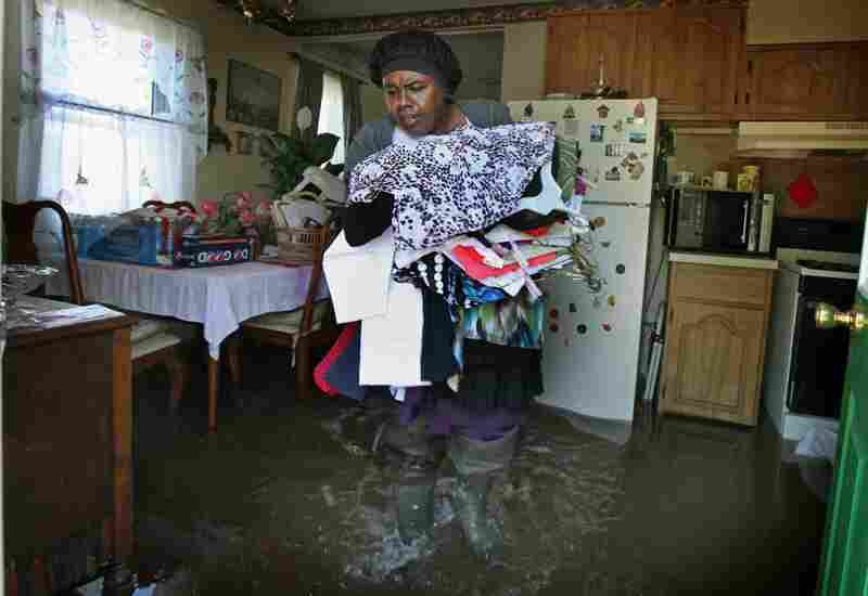 May 4: Sally Nance walks through floodwater as she helps her neighbors collect clothes from their home in Tiptonville, Tenn.