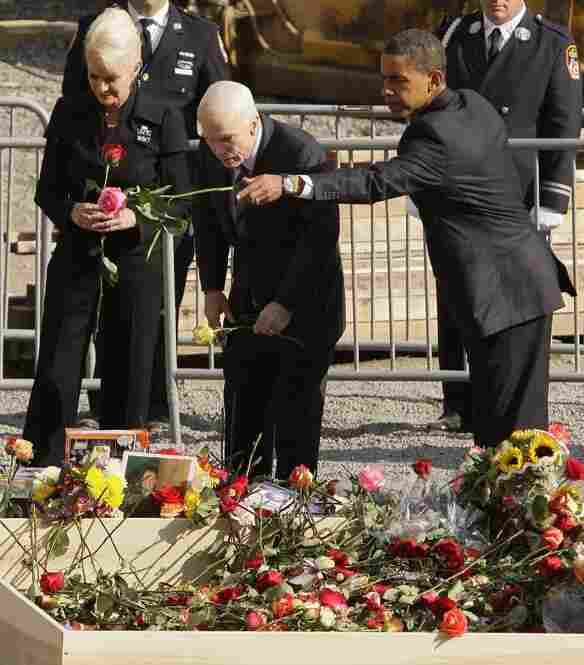 Presidential candidates John McCain, with wife Cindy McCain, and Barack Obama place roses into the reflecting pool at ground zero on Sept. 11, 2008, the seventh anniversary of the attacks on the World Trade Center.