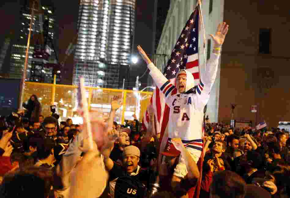 A jubilant crowd near ground zero reacts to the news of Osama bin Laden's death in the early-morning hours of May 2.