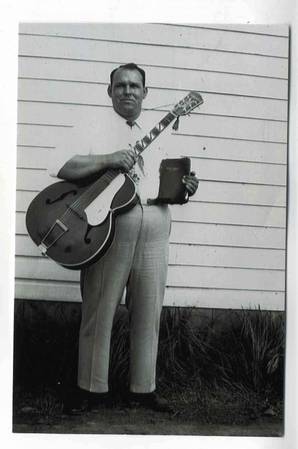 Brother Claude Ely, pictured in 1953 in front of the Letcher County Courthouse in Whitesburg, Ky.