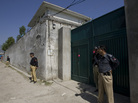 Pakistani police guard the gate of the compound where Osama bin Laden was killed by U.S. forces.