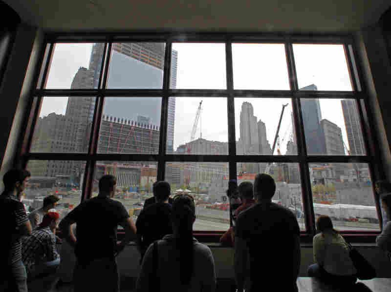In the aftermath of the death of Osama bin Laden, the architect of the Sept. 11 attacks, visitors view the World Trade Center construction site from the World Financial Center building.