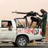 Libyan rebels head to the front line on the outskirts of the eastern city of Ajdabiya on May 1.