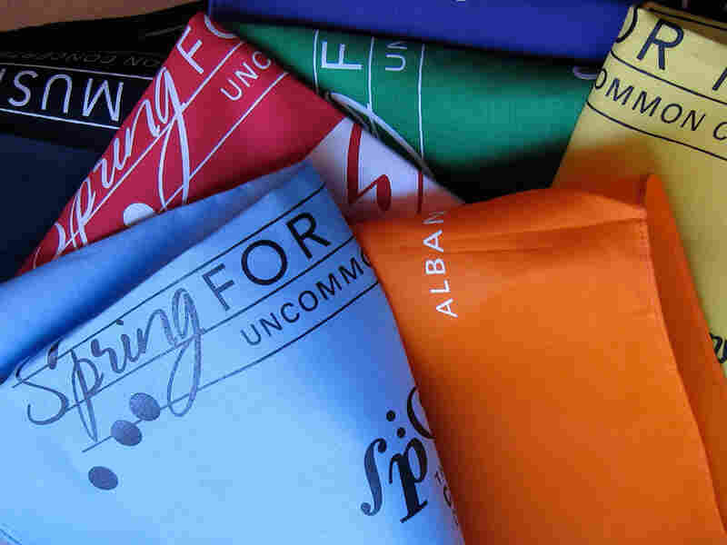 Fans of the Spring for Music Orchestras get their own color-coded hankies.