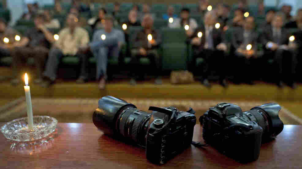 Two cameras are posed symbolically during a memorial service for photojournalists Tim Hetherington and Chris Hondros held in Benghazi on April 21.
