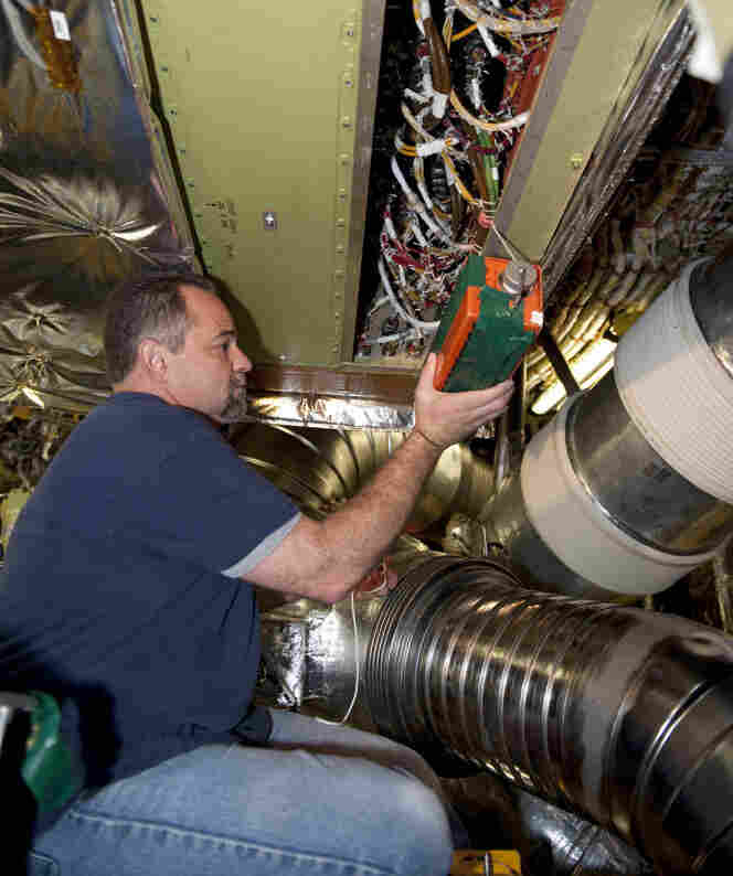 At NASA Kennedy Space Center's Launch Pad 39A, a technician inside space shuttle Endeavour's aft section is testing the Load Control Assembly-2 (LCA-2) for replacement.
