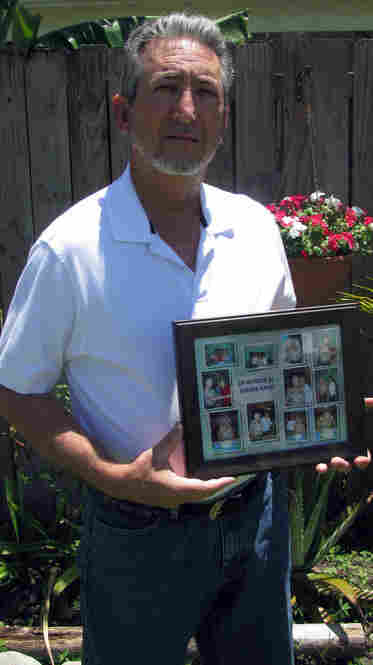 Alfredo Navas holds a photo collage of his mother at his Miami home. The Navas family sued Isabel Lopez's company, saying that negligence led to Aurora Navas's death. The suit was settled for an undisclosed amount. Photo by Kenny Malone, WLRN.