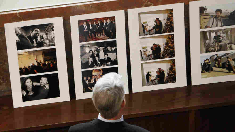 Photographs celebrating the life of Getty Images photographer Chris Hondros are displayed at his memorial service in Brooklyn on April 27.