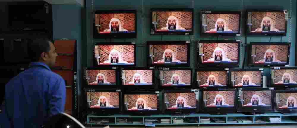 A salesperson in Mumbai, India, watches TV reports on the killing of Osama bin Laden.