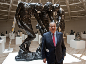 Carlos Slim invested more than $800 million in the Soumaya Museum, the second museum opened by the telecommunications mogul. Here, he stands with Auguste Rodin's The Three Shades on March 28, the eve of the opening.