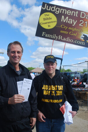 Brian Haubert (right) and Kevin Brown hand out Judgment Day pamphlets in Palmyra, N.J.