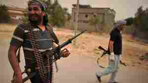 Libyan rebels patrol near the airport at al-Ghiran, close to the key port city of Misrata, on April 30.