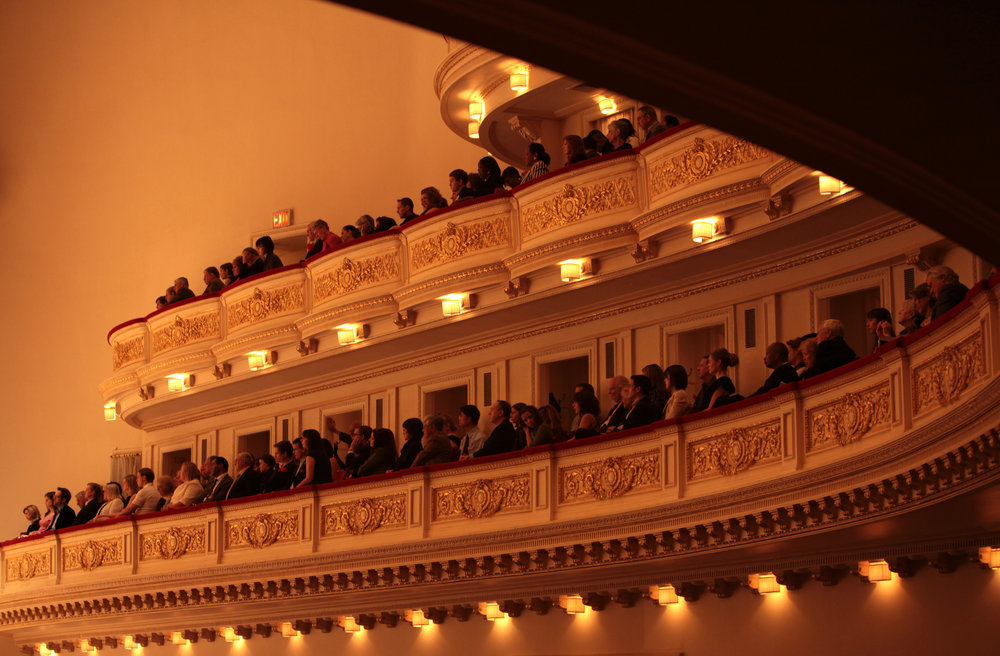 "The audience watches the Toledo Symphony with Stefan Sanderling, Principal Conductor, performing ""Symphony No.6 in B minor, Op. 54"" by Dmitri Shostakovich during the first half of the Spring for Music festival at Carnegie Hall in Manhattan, New York on May 07, 2011."