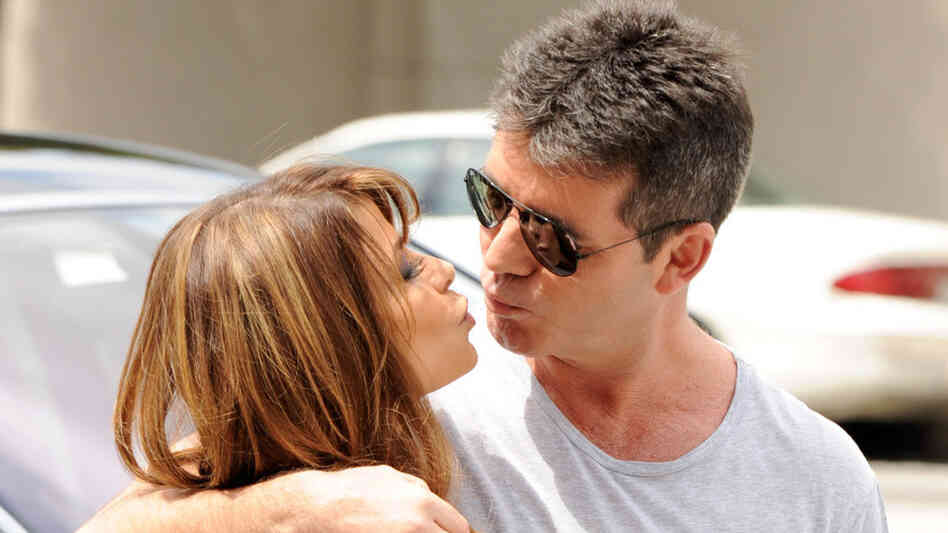 Paula Abdul (L) and producer Simon Cowell arrive at the first round of auditions for Fox's The X Factor.