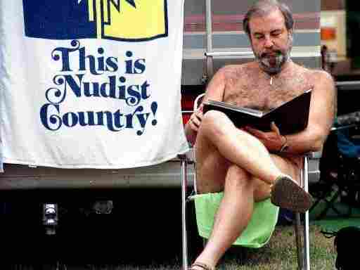 John Kinman, from Kona, Hawaii, sits and goes over papers at the Willamettan nudist camp in Marcola, Ore., Wednesday, Aug. 11, 1999. Many nudist groups now face an aging membership and little interest from younger generations.