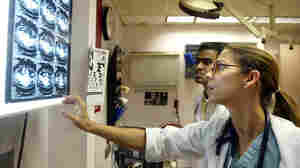 A doctor views CT scans in the emergency room at Coney Island Hospital in New York.