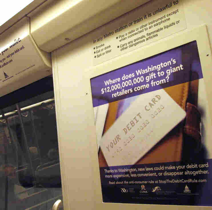 Ads like these — from the Electronic Payments Coalition — appear in about 100 rail cars within the Washington, D.C., Metrorail system.