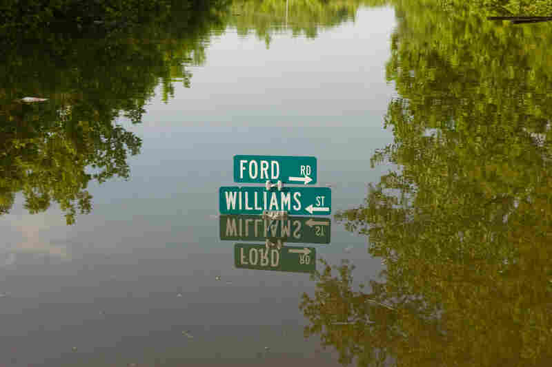 MAY 9: A street sign in the Ford subdivision is nearly submerged  in Vicksburg.