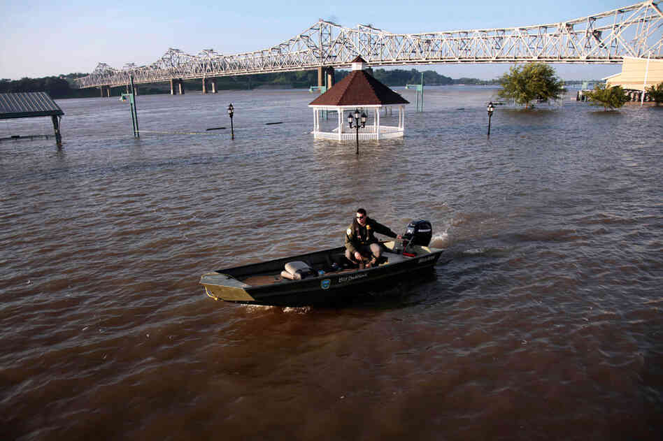 MAY 19: A corrections officer motors through floodwaters of the Mississippi River to pick up prison trustees, who are being used for flood-abatement work in Vidalia.