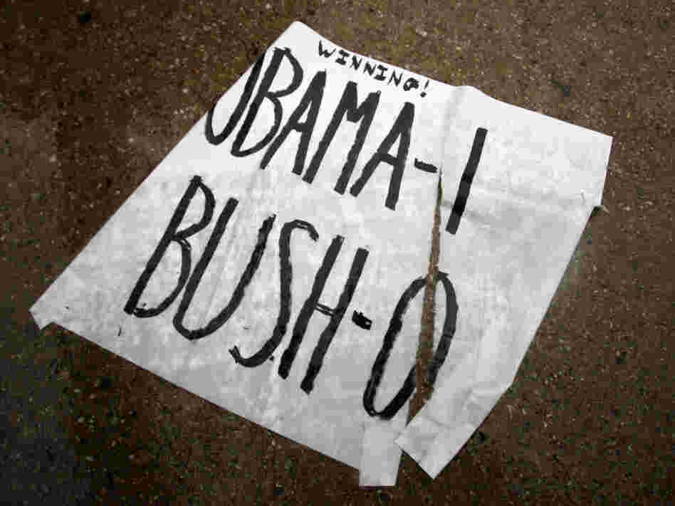 A rain-soaked sign sits on the ground in front of the gated Dallas  neighborhood of former President George W. Bush in  Dallas, Texas, on  May 2 after President Obama announced that  Osama bin Laden was killed in an operation led by the United States.