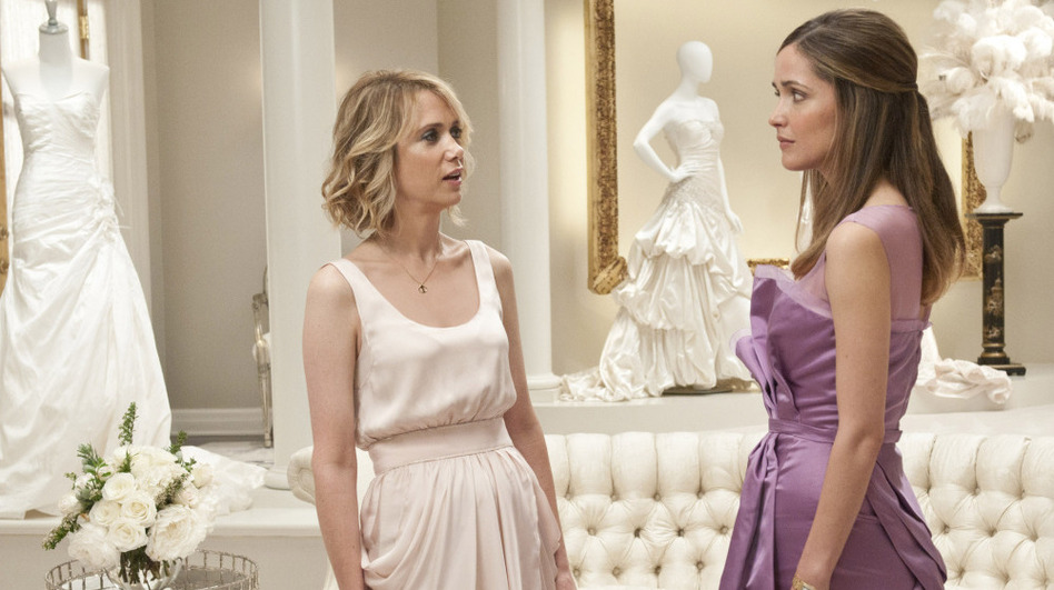 Wiig and Byrne square off in a bridal shop, minutes before an unfortunate food poisoning episode. (Universal Pictures)