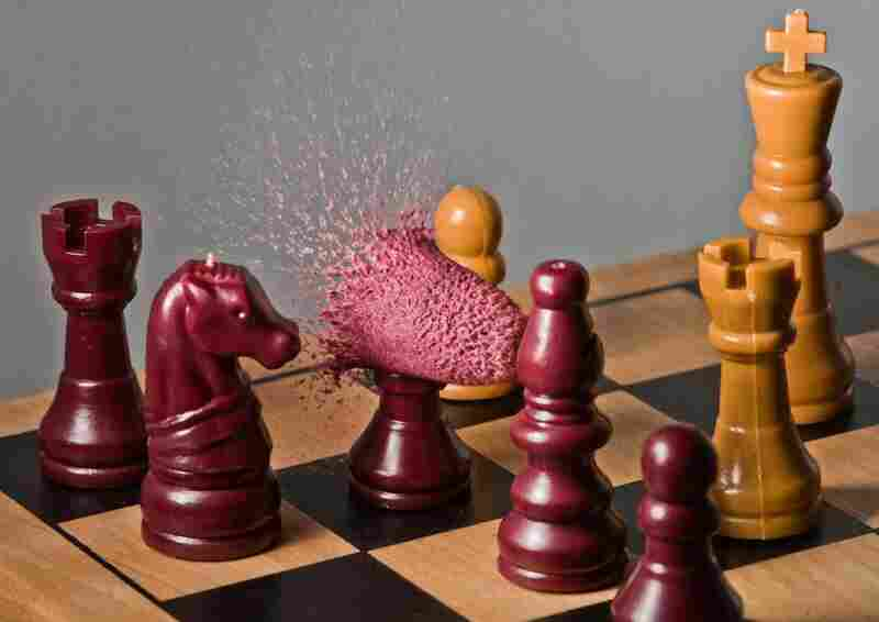 "Pwned: ""Got the chess set at a garage sale for a buck. Replaced the head of one pawn with some Play-Doh. Aligned things carefully."""