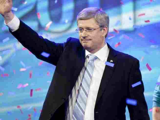 Canadian Prime Minister Stephen Harper waves to supporters gathered in Alberta, Canada, as he celebrates the election of a Conservative majority government in the federal election. Harper won re-election last week.