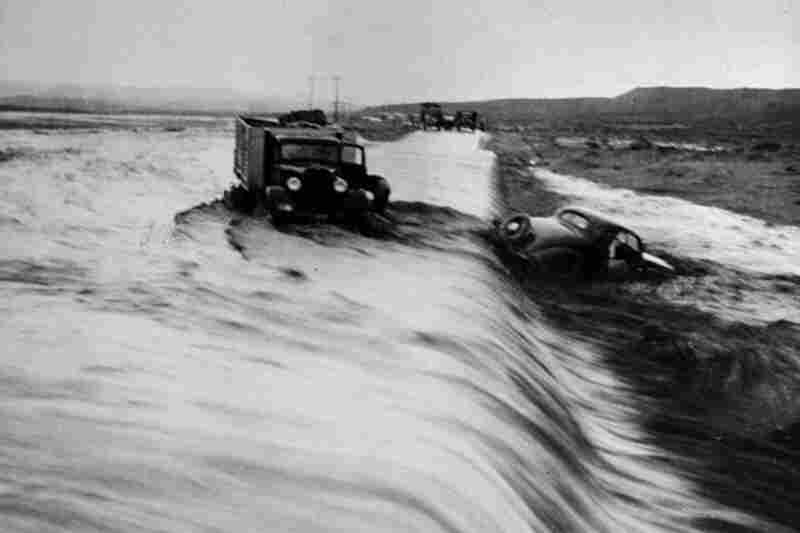 Cars and trucks in this unknown location are swept away by the raging Mississippi River during the Great Flood of 1927. The flooding along the Mississippi, Arkansas and Red rivers officially killed 246 people and displaced some 700,000 others.