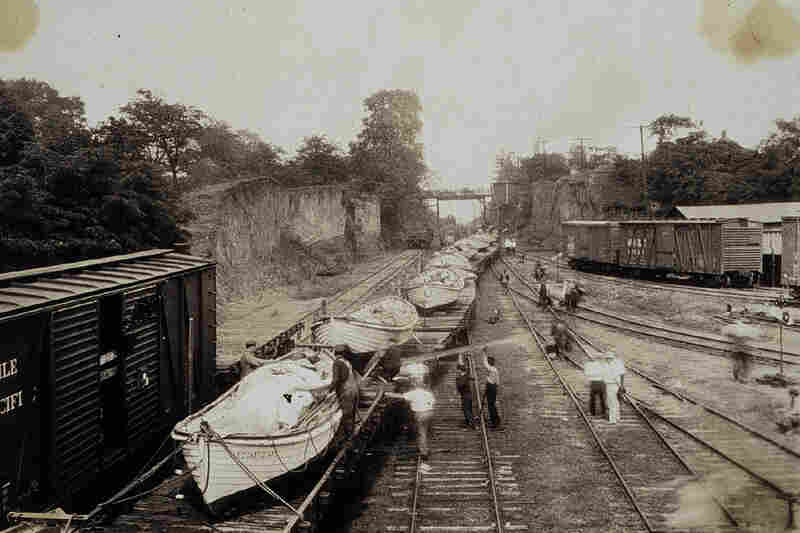 Lifeboats from New England and the Great Lakes arrive by train in Natchez, Miss., 1927