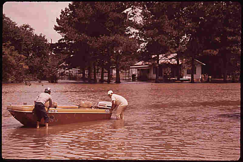 Residents of Gibson, La., rely on boats for transportation during the 1973 flood.