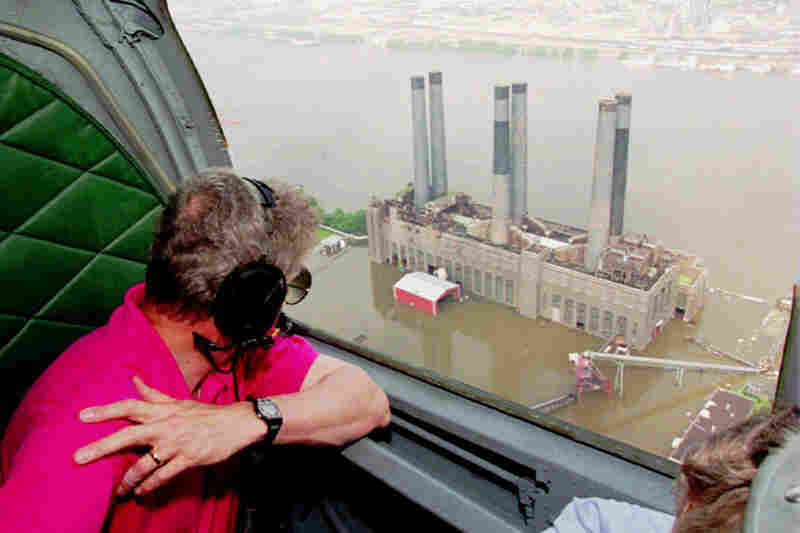 President Bill Clinton surveys a power plant where the Mississippi and Missouri rivers meet near St. Louis. The flooding in the Upper Mississippi Valley in 1993 affected nine states and caused billion of dollars in damage.