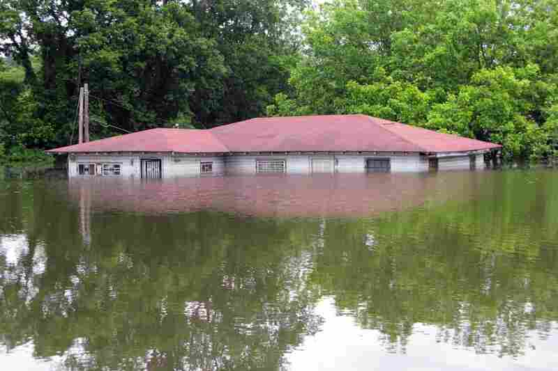 MAY 15: The flooding in Vicksburg, Miss. has put many houses underwater. Only the roofs are visible on others, like this one.