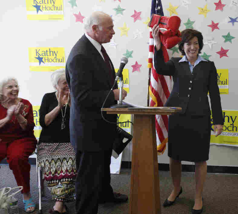 Congressional candidate Kathy Hochul accepts a pair of boxing gloves from Max Richtman of the National Committee to Preserve Social Security & Medicare, Monday, May 9, 2011.