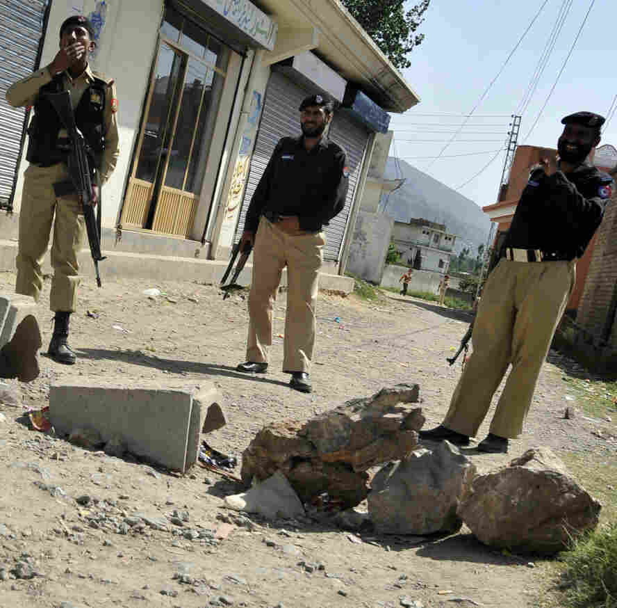 Pakistani military and police officials cordon off a street leading to the final hideout of al-Qaida chief Osama bin Laden in Abbottabad, Pakistan, on Monday (May 9, 2011).