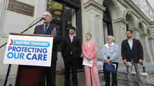 Supporters of President Obama's health care policies hold a rally Tuesday in front of a federal court in Richmond, Va.