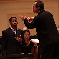 """Albany Symphony conductor David Alan Miller leads the orchestra and baritone soloist Nathan De'Shon Myers in """"The Spirituals Project"""" live at Carnegie Hall."""