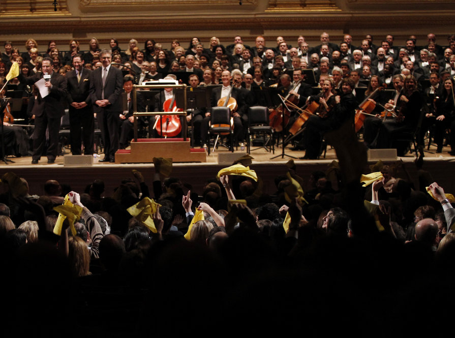 Members of the Carnegie Hall audience wave their speical yellow bandanas to signify that they are from Texas before the Dallas Symphony Orchestra concert at the Spring for Music festiva at Carnegie Hall.