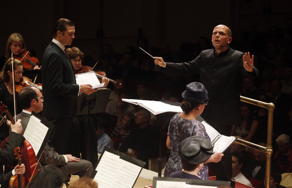 Conductor Jaap van Zweden leads the Dallas Sympphony and Chorus, with soloists Rod Gilfry (left) as LBJ, and soprano Indira Mahajan (right) as Mrs. Chaney, one of the mothers of the slain civil rights workers.
