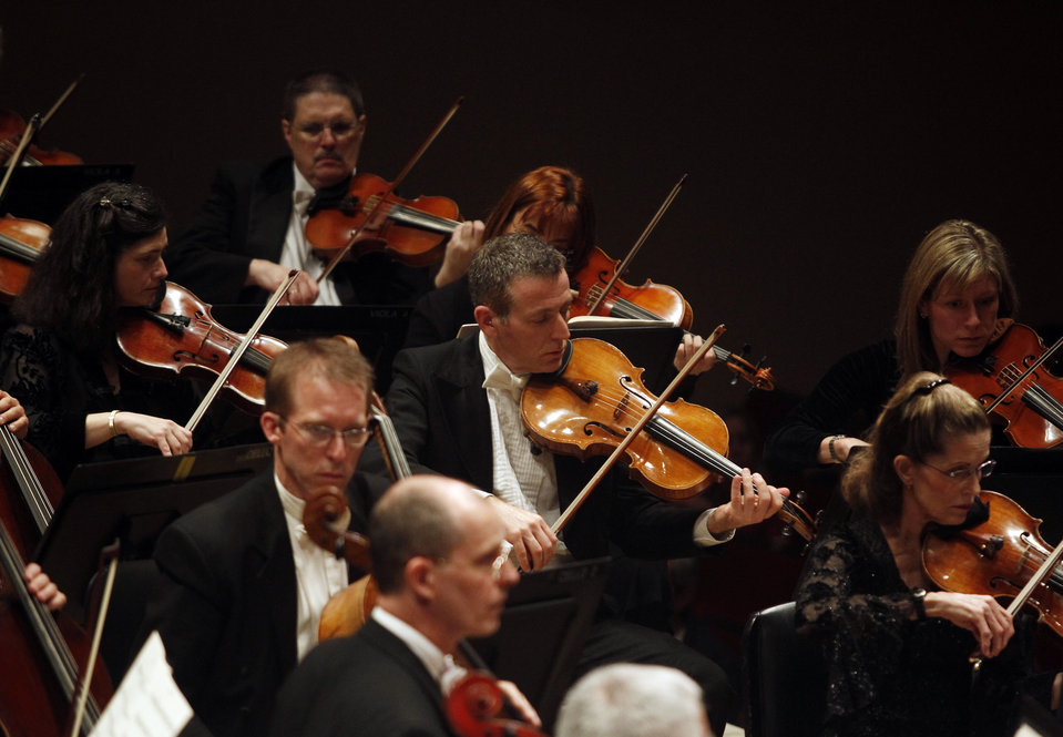 The Dallas Symphony Orchestra string section.