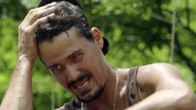 """Rob Mariano, during  the immunity challenge,  """"Step On Up,"""" during last week's Survivor."""