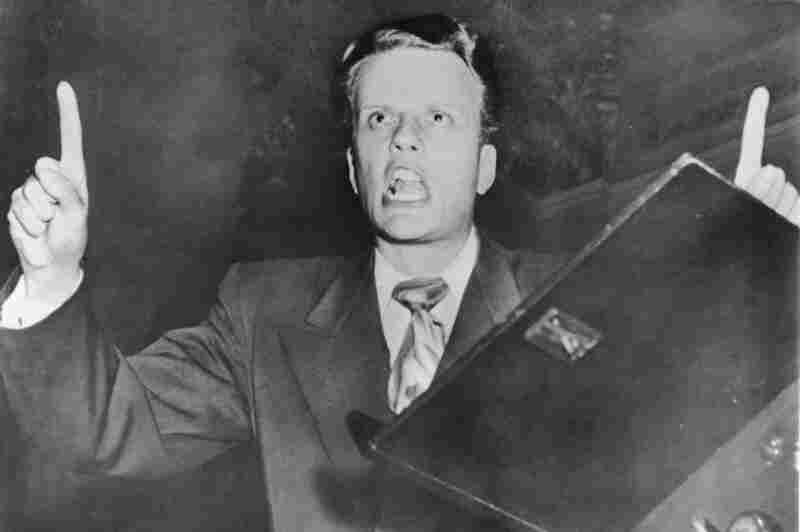 Graham preaches in the early 1950s. Over his career, he preached to more than 200 million people in 185 countries, radically changing the face of born-again Christianity.
